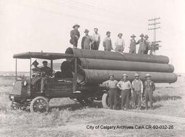 Waterworks crew with pipe loaded on truck