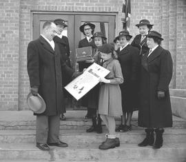 Girl Guide Anthea Dykes shows the Friendship Scroll to Mayor Morley Merner on the steps of City H...
