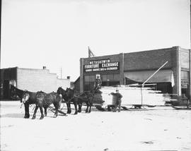 Team of horses pulling a load of lumber, Wetaskiwin, Alberta