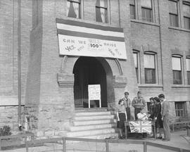 Wetaskiwin High School war savings display and committee, in front of the Alexandra School buildi...