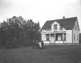 Tom Cherrington's family in front of their house, Wetaskiwin, Alberta