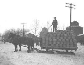 A ten ton load of wire being delivered to Chalmers' Hardware by L.G. Kelley's dray, Wetaskiwin, A...