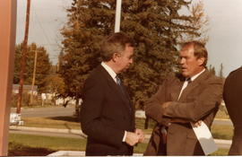 Right Honorable Joe Clark talking to man.