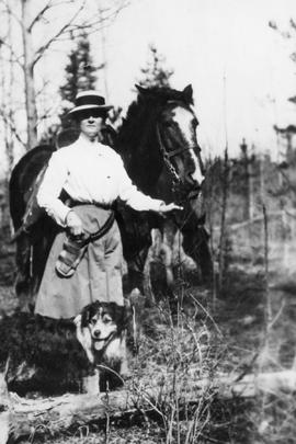 Woman, horse & dog.