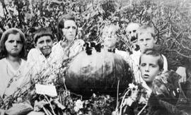 Collins family with prize pumpkin.