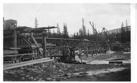 Building bridge across Athabasca River to Lodge, Jasper, Alberta.