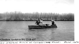 Rod Settee, E. W. Dodds, and J. E. Carriere, in a boat on the Bigstone River, at Cumberland House, Saskatchewan.