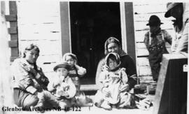 Ojibwa women and children at Hudson's Bay Company (HBC) post, Long Lake, Ontario.