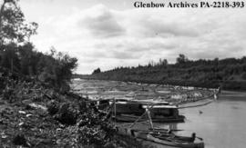 Log boom at Knudson's Mill on the Saskatchewan River, near Cumberland House, Saskatchewan.