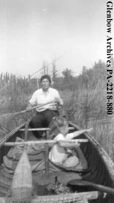 Beatrice Olsen, (nee Brown), and little girl, in canoe, on Nemeiben Lake, Saskatchewan.
