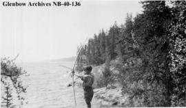 Ojibwa boy with bow and arrow, Long Lake area, Ontario.