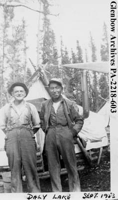 """Oscar Nelson and Thomas Ballantyne at pioneer contractors' camp, Daly Lake"", Saskatche..."