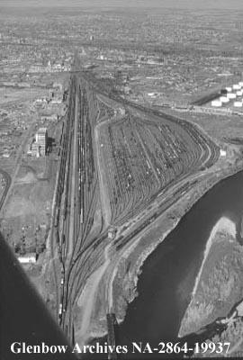 Aerial views of Canadian Pacific Railway yards and Mount Royal College nearby, Calgary, Alberta.