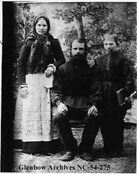 Slavic family of three in costume, Crowsnest Pass area, Alberta.