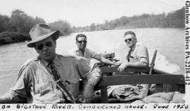 C. L. MacLean, James Carriere, and R. N. Gooding, in a boat, on the Bigstone River, Cumberland Ho...