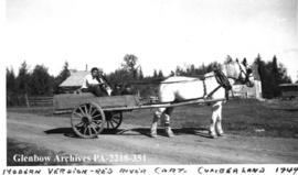 Family being transported in a modern version of a Red River cart, Cumberland House, Saskatchewan.