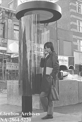 Debbie Breckenridge using one of the new telephone booths on 8th Avenue Mall [Stephen Avenue], Ca...