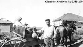 Family with their democrat wagon, Blackfoot (Siksika) reserve, Alberta.