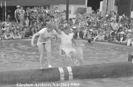 Bobby Orr gets dunked in log roll, Calgary, Alberta.