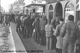 "Lineup of people wishing to see ""The Exorcist"" at the Palace Theatre, Calgary, Alberta."