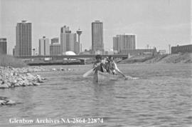 Canoeing down the Bow River, Calgary, Alberta.