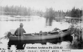 Bert Wagonitz, of Detroit, Michigan, in canoe, on the Great Slave Lake to Great Bear Lake route, ...