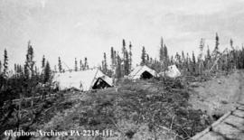 Camp at head of Great Bear River portage road, Northwest Territories.