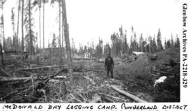 Simeon Bloomfield at McDonald Bay logging camp, Cumberland District, Saskatchewan.