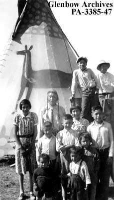 White Headed Chief and his family, Blackfoot (Siksika) reserve, Alberta.