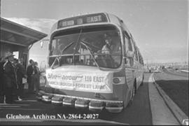 Mayor Sykes driving Blue Arrow bus, Calgary, Alberta.