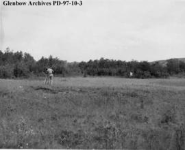 Surveying, Cluny Earthlodge Village archaeological excavation, Blackfoot (Siksika) reserve, south...
