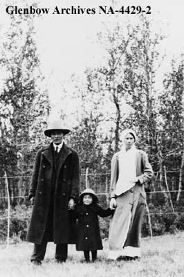 Joe Bull Shield with wife, Dorothy, and child, probably Blood reserve, southern Alberta.