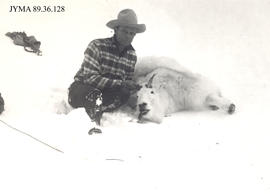Hunter with hunting trophy, Jasper National Park, Alberta.