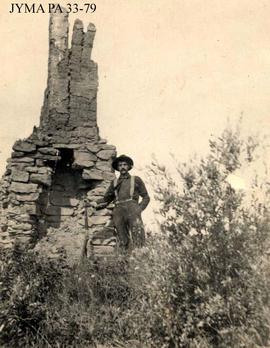 Bruce Otto by the remains of a chimney at Rocky Mountain House, Alberta.