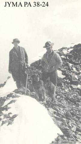 Curly Phillips and his dog with an unknown woman on an outing.