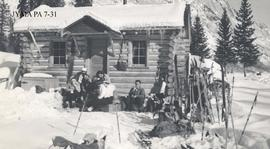 Skiing party in front of the wardens cabin at Medicine Lake, Jasper National Park, Alberta.