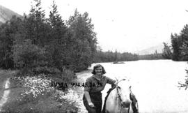 Eleanor Broadhead and horse at the Mount Robson Dude Ranch, British Columbia.
