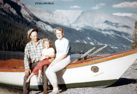 The Jeck family and the warden's boat at Maligne Lake, Jasper National Park, Alberta.