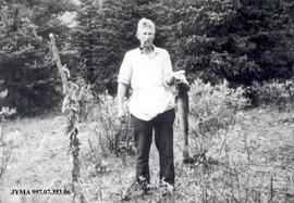 A.B. Webb with fish, Jasper, Alberta.