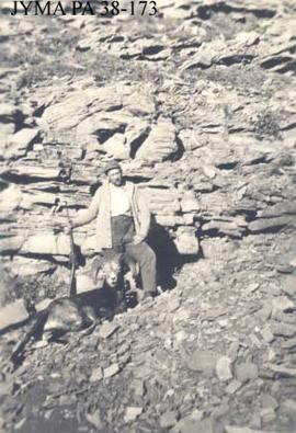 Unknown hunter with bighorn sheep trophy.