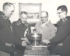 Jack Hilworth, Jack Hargreaves, Ken Allen and Johnny Waines with the Dunlop Tire Curling Trophy, Jasper, Alberta.