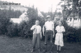Whit Borrow, Robert and Jean Fallowfield with a fish, Jasper, Alberta.
