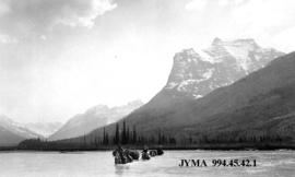 Group fording the Chaba River, Jasper National Park, Alberta.