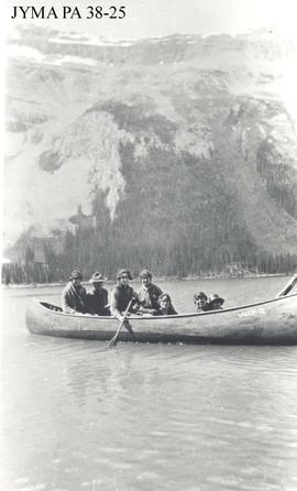Curly Phillips and a group of unknown women in a canoe, Jasper National Park, Alberta.