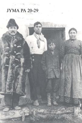 Ewan Moberly family in front of their house in Grande Cache.