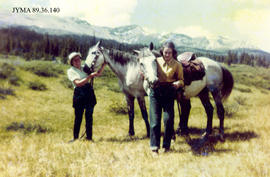 Horses and riders at Moose Horn, Jasper National Park, Alberta.