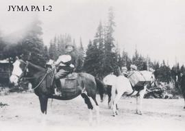 Group on pack horses at Berg Lake, Robson Pass.