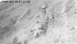 [Hunter with Rocky Mountain Sheep], Alberta