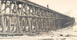 Construction of a railroad trestle bridge at Dandurand, Alberta.