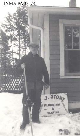 Fred Stone outside his home and business in Jasper, Alberta.
